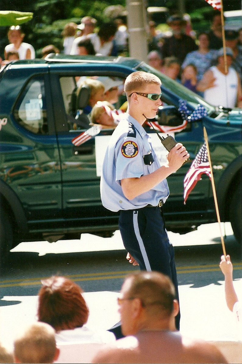 Craig working the crowd of the 4th of July Parade as a Kenosha Police Explorer in 1999.