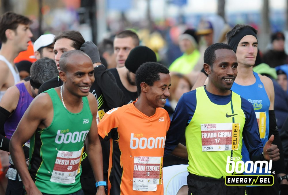 Desta and fellow Ethiopian Dadi Beyene sharing a laugh on the start line at 2016 Philadelphia Marathon