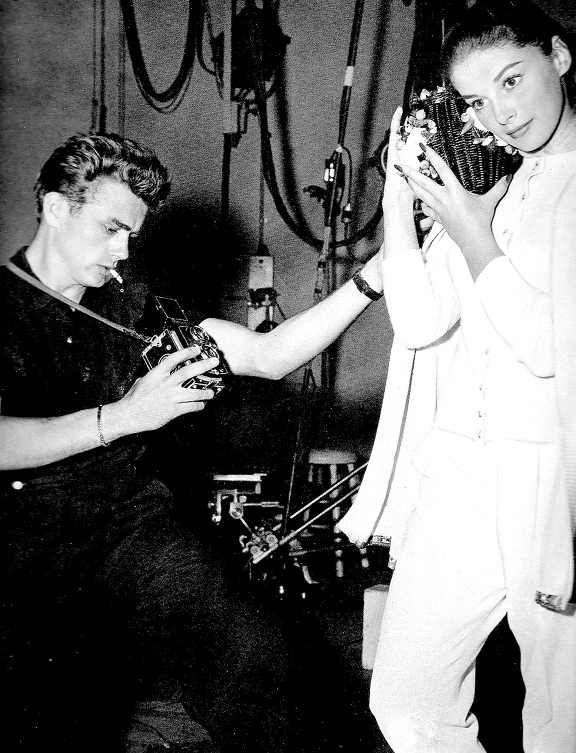 James Dean taking a photograph of Anna Maria Pierangeli with a Rolleiflex