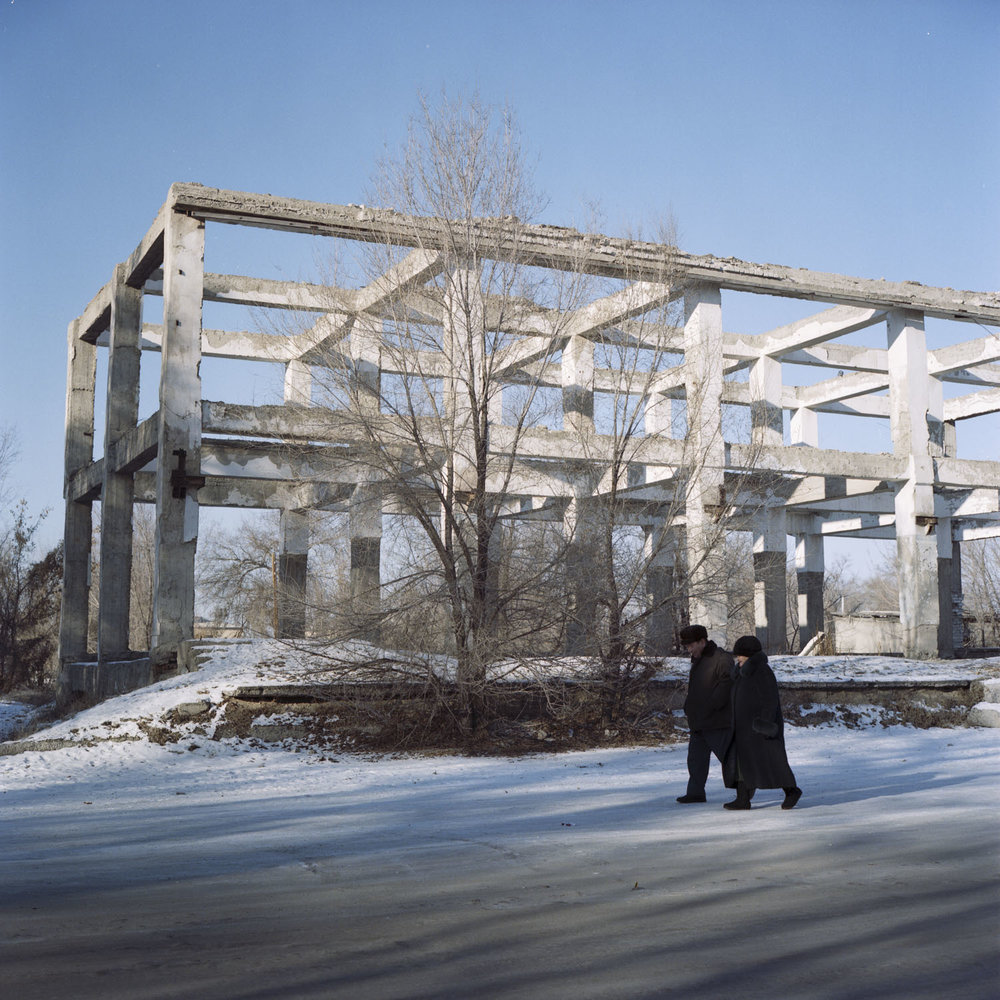 Skeleton frame of a Soviet building in Ushtobe, Kazakhstan, the first place Koreans were deported to in 1937, now known as the Korean District of Kazakhstan. Most Koreans have now moved to bigger cities in search of socioeconomic success. Ushtobe, Kazakhstan. December 2014.