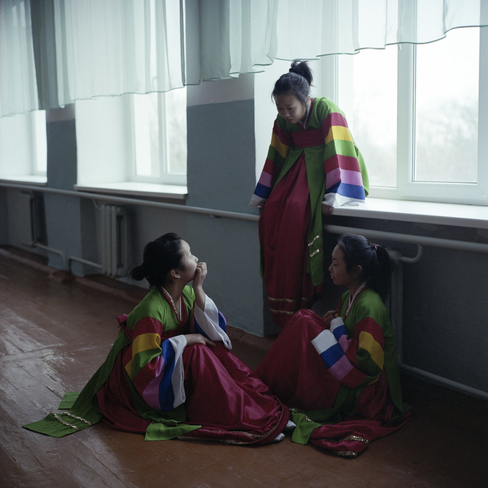 Ethnic Korean teenagers wearing traditional dresses after a rehearsal in the first Korean-language school of Kazakhstan, where decades ago nine out of ten students were ethnic Koreans. Today, only one out of ten students is Korean, and Russian is the main language used in the school, but students can still take optional classes in Korean language, music, and dance. Eskeldy-bi, Kazakhstan. January 2015.