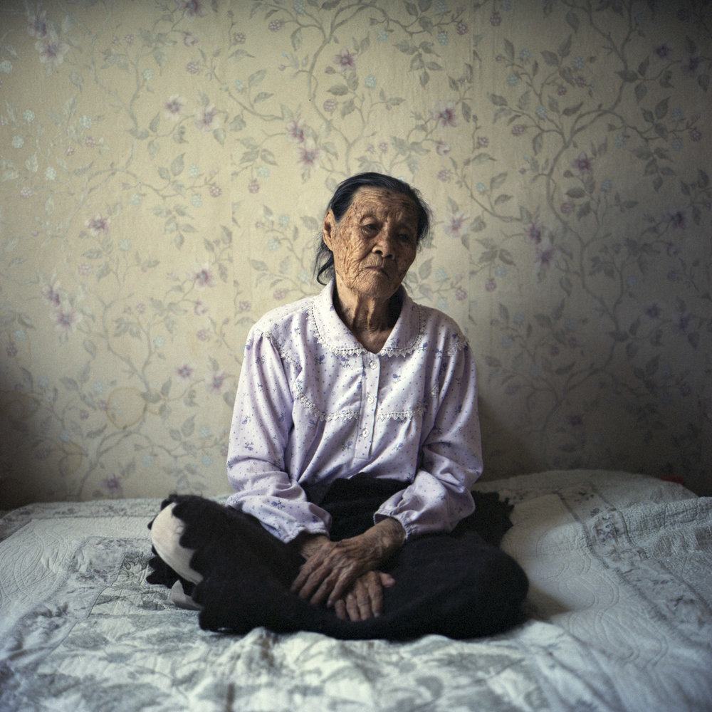 Sung-ok Tigay, 92, was deported from Vladivostok at the age of 13 and lost her parents soon afterward. She recalls that while living in earth dugouts that Kazakhs helped them dig, up to five people per dugout might die overnight due to the cold weather, illness, or starvation. Nowadays, Sung-ok sings herself to sleep with old Korean folksongs. She used to sing many of these songs in the rice fields of the arid Kazakh steppe, where she worked until her hands became fractured. Ushtobe, Kazakhstan. September 2014.