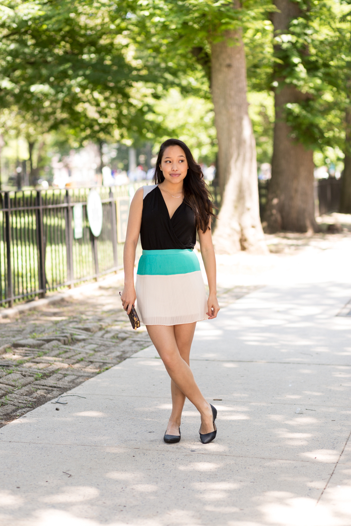 Melanie Sutrathada of Lace and Combat Boots, a fashion and lifestyle blog based out of New York City. Melanie is wearing a Cindy and Johnny top, a pleated Forever 21 skirt and black Express flats.jpg