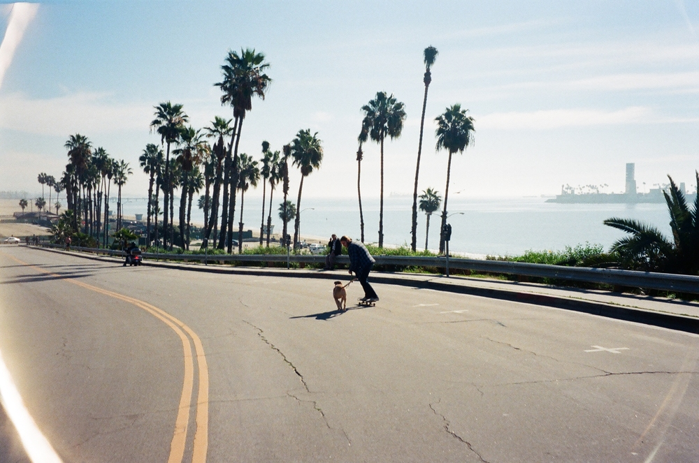 """""""One of my personal favorites, Jon Dickson. Walking his dog Darling down the main strip of Long Beach. Same path takes us to a fun spot or fishing hole :)"""""""