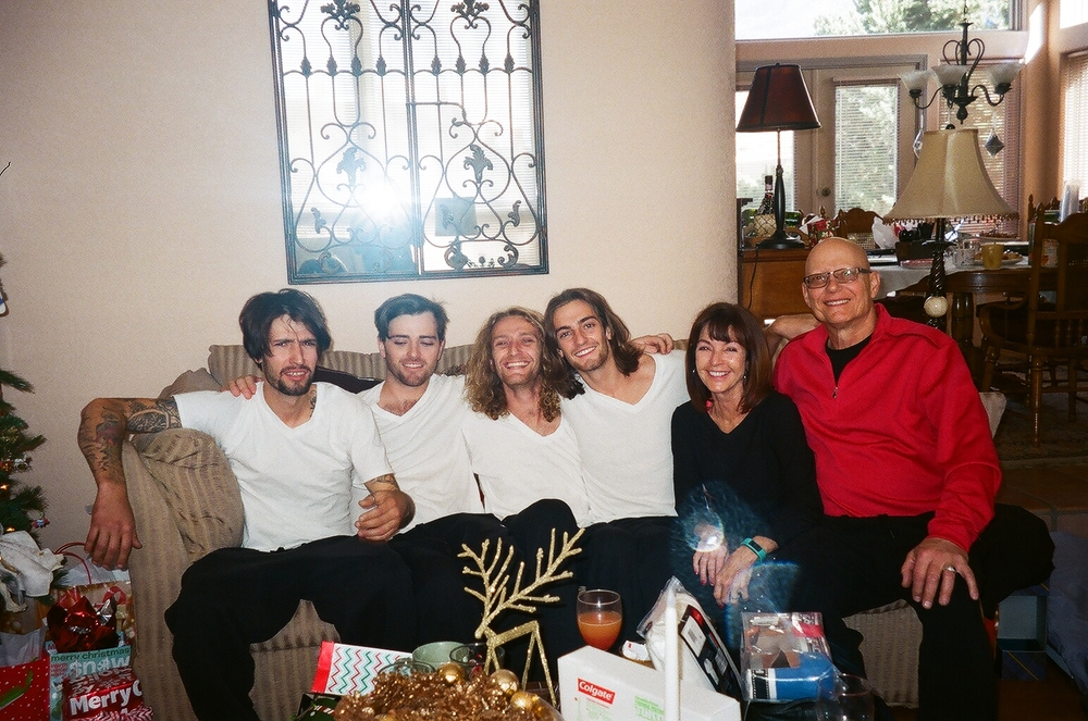"""My beautiful one of a kind family, Christmas 2014. The epitome of us is in moms smile. You'd never be able to tell how much life's handed her or my dad by the way they carry themselves. Eternally grateful. """