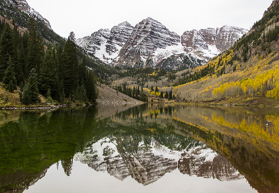 Pyramid Peak and the Maroon Bells are reflected in Maroon Lake.  Even if all of the elements are less than perfect, take the shot anyway as the weather may deteriorate later, or worse, you may never get to that spot again.