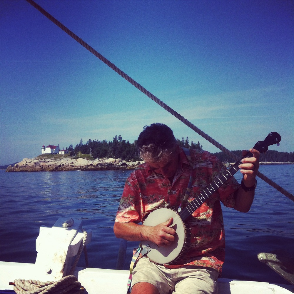 Cook and moto mentor, Greg Dorr, picking the banjo to the rhythm of the sea.