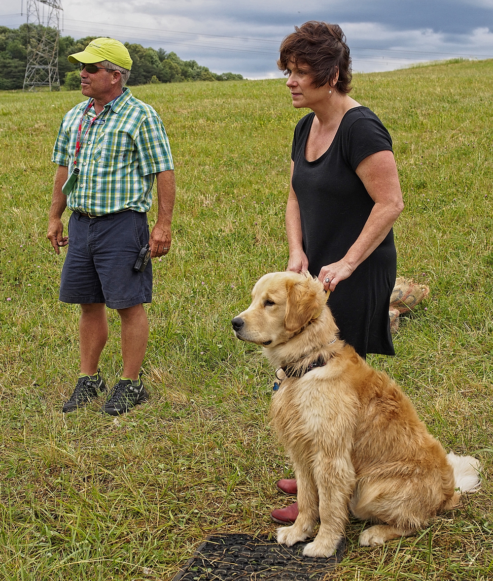 Pat with wife Robin and her golden, Leo.
