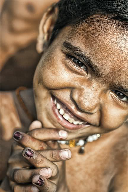 A little one in a city dump outside of Kolkata.