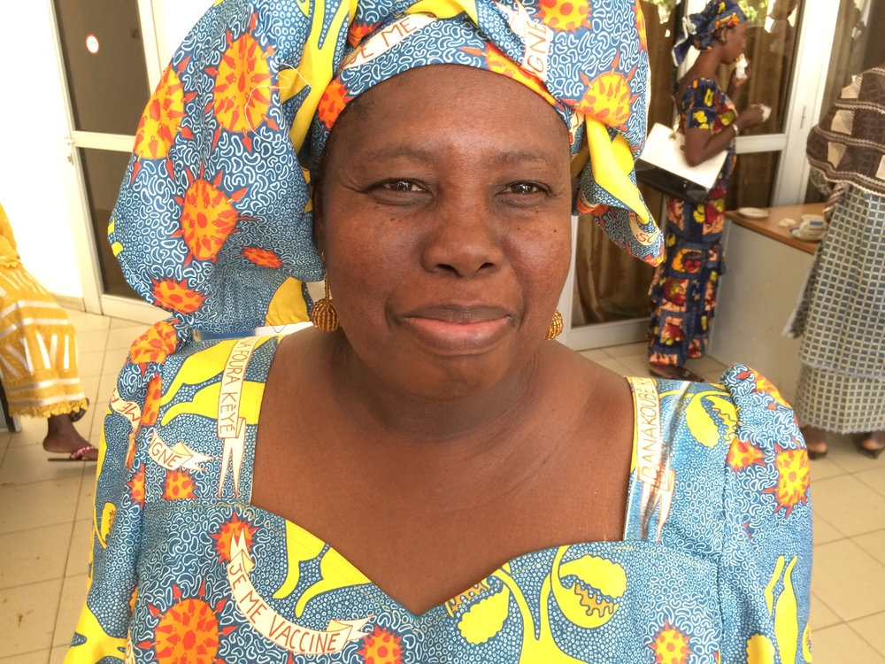 Mme Badiallo, president of the women's organization in Sikoro and GAIA peer educator, wearing the HPV story-telling cloth