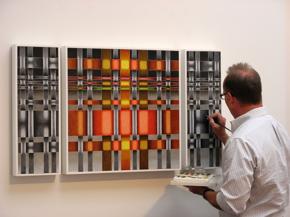 Mark Leonard performs a last minute touch up before the opening of Intersections. Louis Stern Fine Arts, 2011.