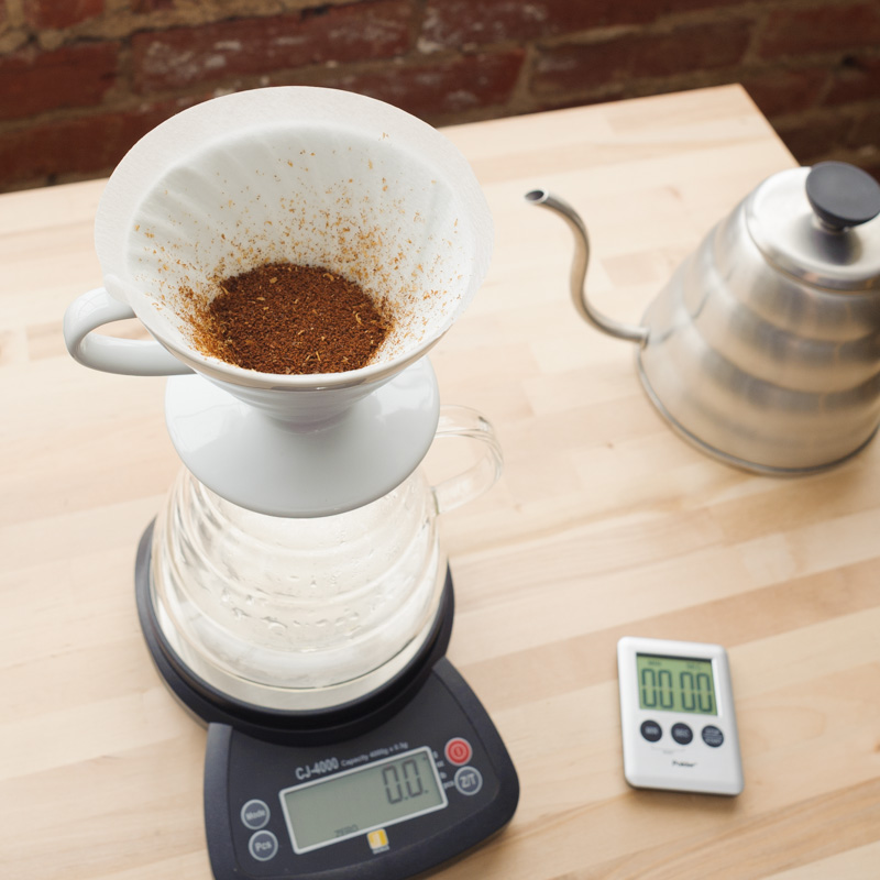 3. Grind coffee on medium setting, place in filter and shake lightly to evenly distribute coffee.  NOTE: Grind size and consistency will effect brew time and extraction. Adjust as needed for desired results.