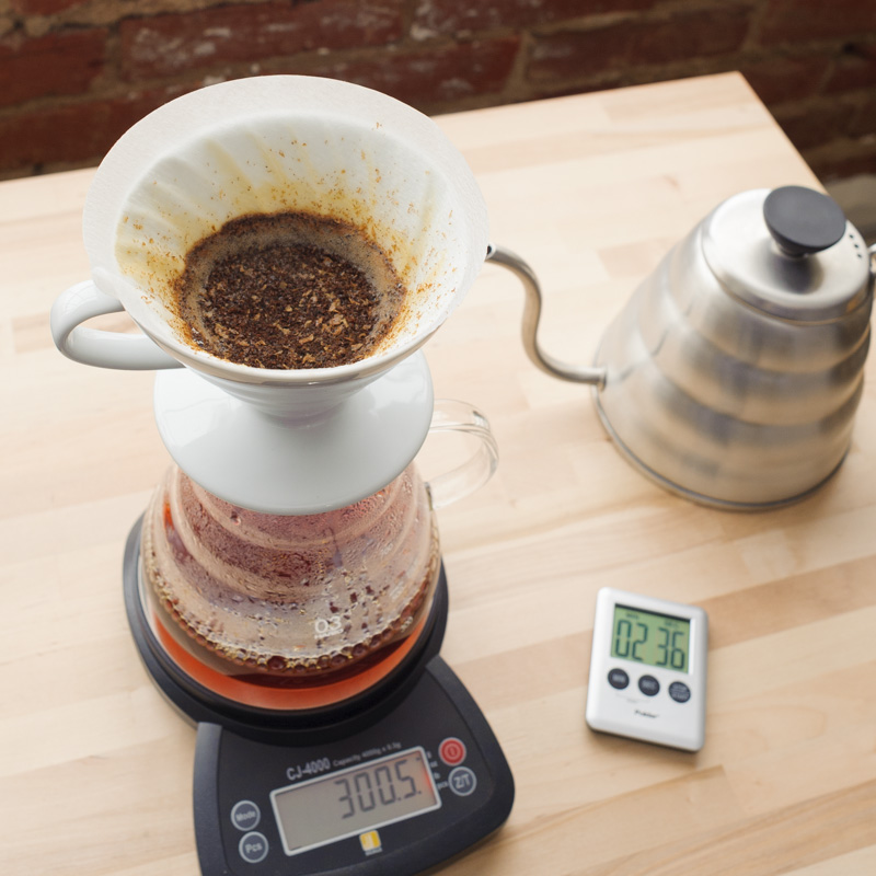 7. Pause to allow water level to drop just above the bed of coffee. Using a combination of agitation and strait pouring, add water in 50g increments till 300g is reached. Total brew time should be between 2:30 - 3:00 minutes.  NOTE: Agitation and pour speed will effect brew time and extraction. Adjust as needed for desired results.