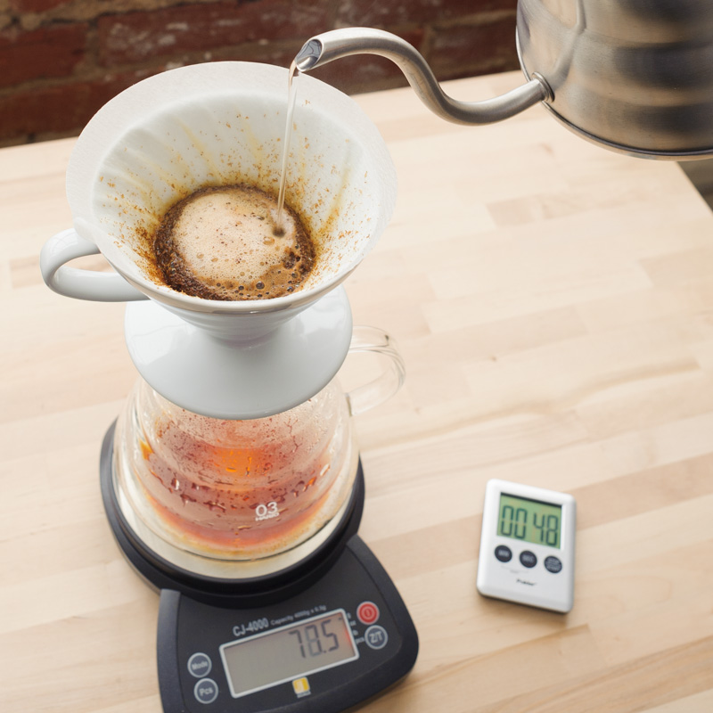6. Gently agitate coffee by pouring in circular motion till 100g of water is reached, then continue to pour into the center of the brewer till 150g of water is reached.