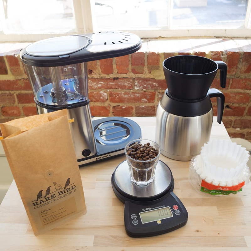 """1. Weigh out coffee. 70g for 8 """"brewer cups"""" (5oz each) of water. 35g for 4 cups."""