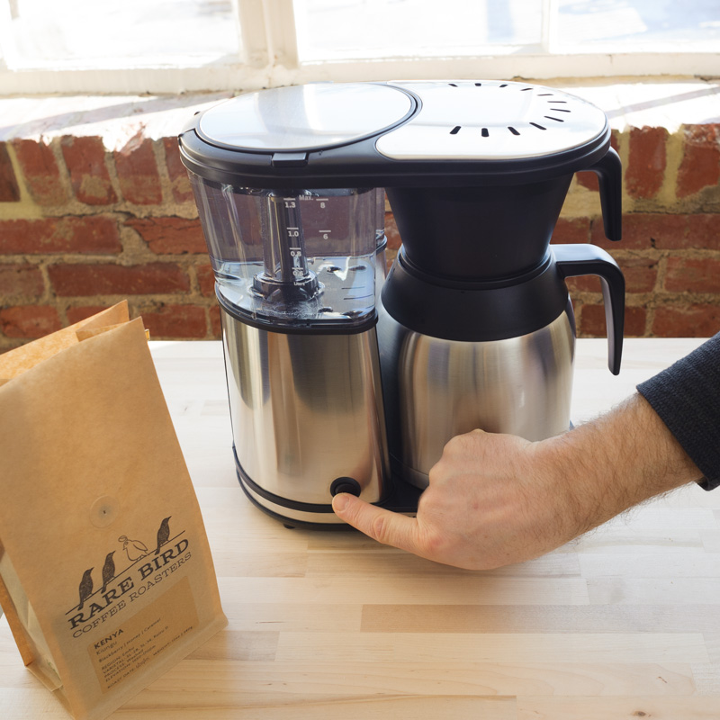 5. Place carafe and brew basket in coffee maker and press power button.