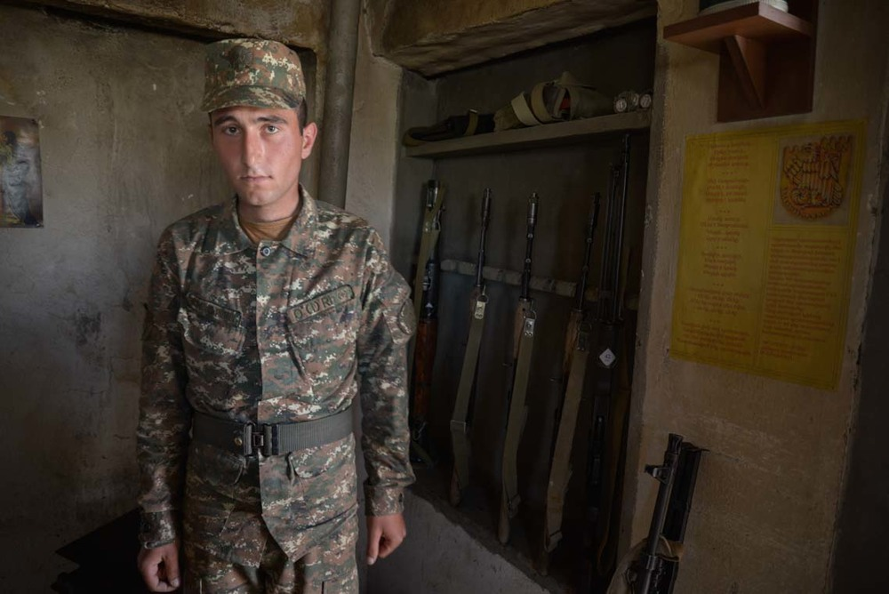 A frontline soldier of the Republic of Nagorno-Karabakh poses in front an arms' cabinet at a military post in the region of Martuni, south-west Nagorno-Karabakh. Soldiers from Nagorno-Karabakh and Armenia guard a 240km border which divides the internationally-unrecognized Repupublic of Nagorno-Karabakh and Azerbaijan. Ongoing peace negotiations between the two sides are currently frozen.