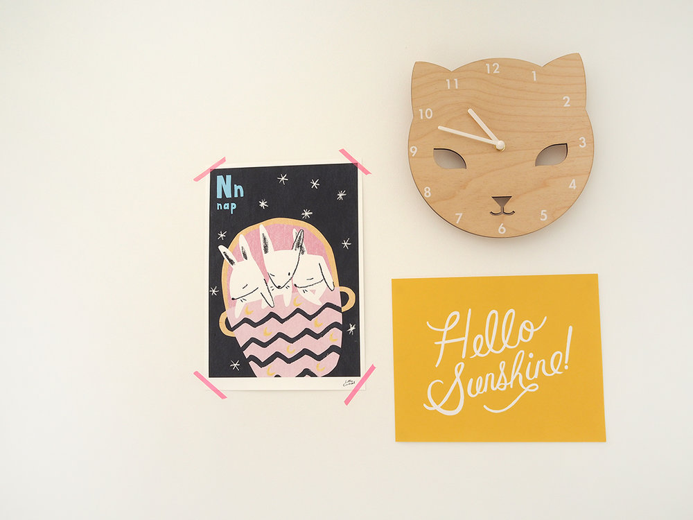 Nap print , £18 - Little Carousel;  Cat clock , £25, Red Hand Gang,  Hello Sunshine print , £16, Papermash