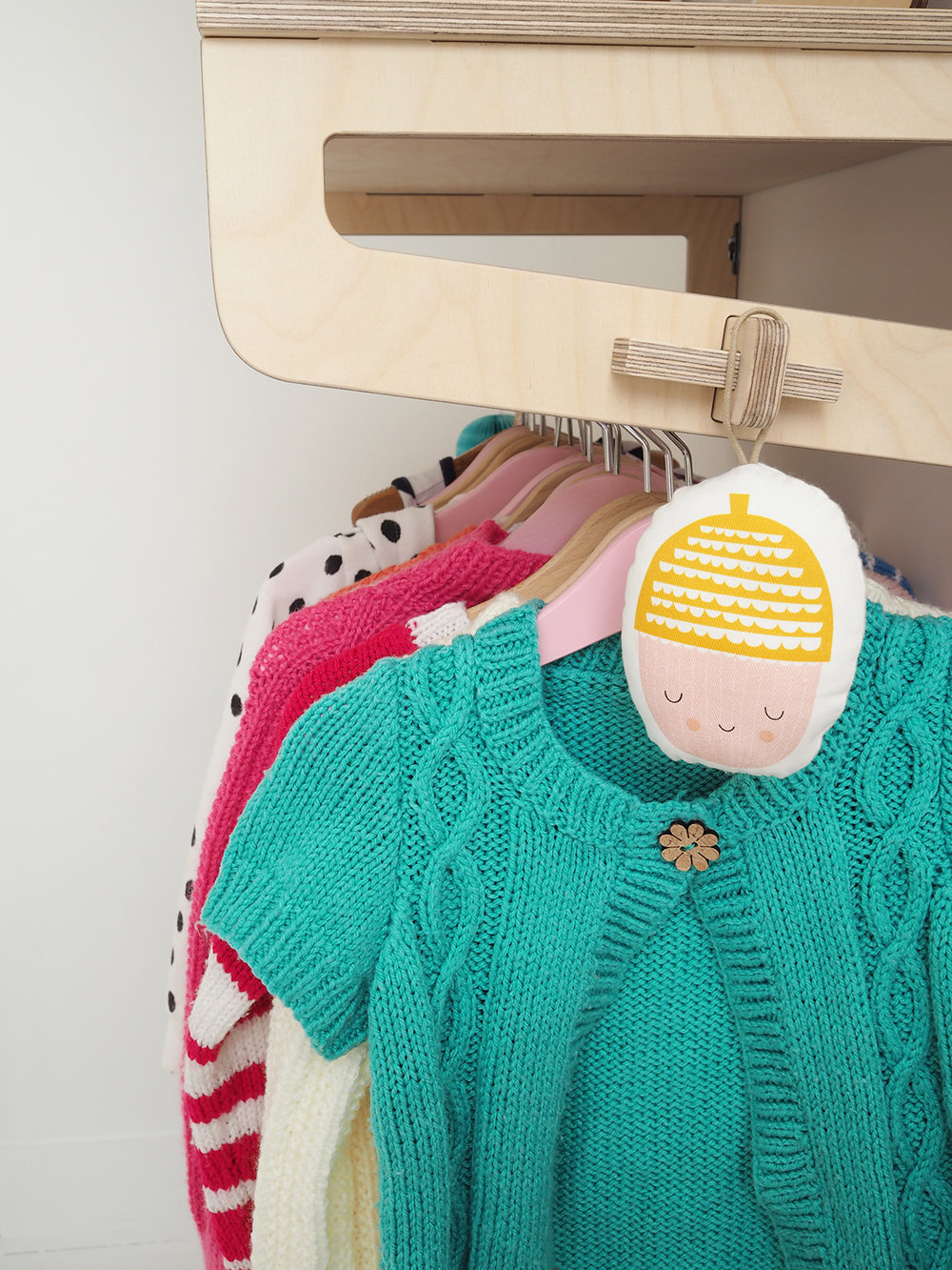 hanging decoration is by Hesperoo, but doesn't seem to be available anymore; Hangers, £3 for 5, Ikea; Knitwear by Ruby's nanny!