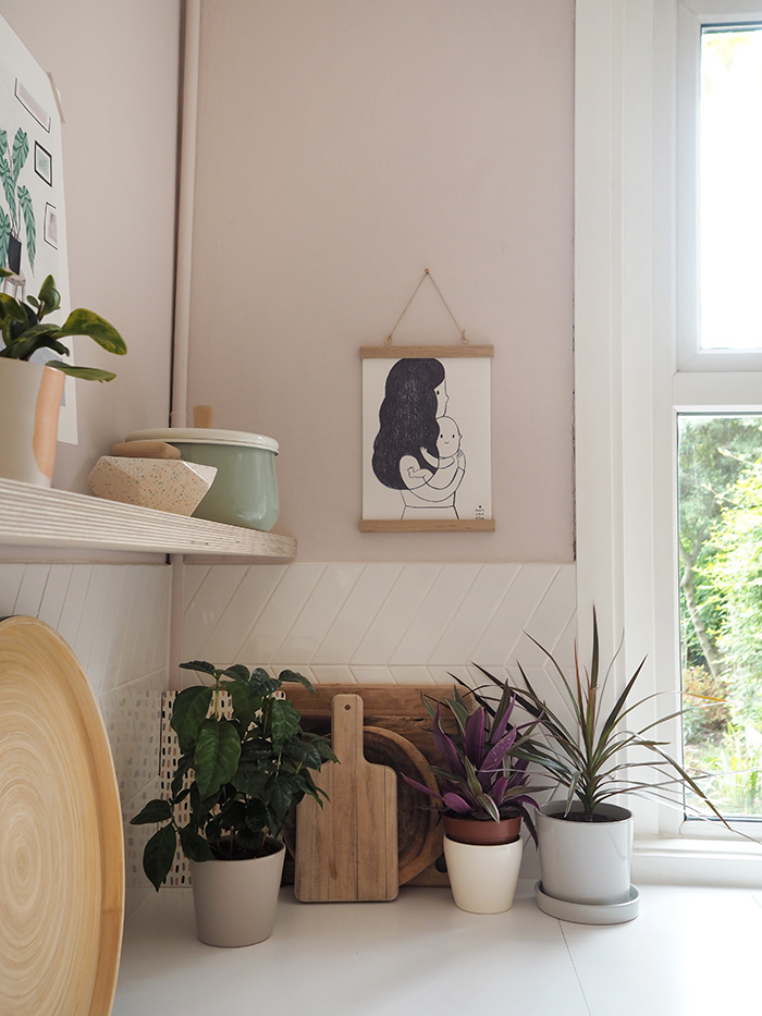 The mother and baby print is by  Marta Abad Blay *, and the poster hanger came from  Desenio . The plant pot on the far right is from  Arket , while the others are from local garden centres.