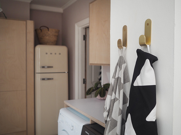 Gold hooks were from  Monpote ; the black and white tea towel is by  Happy and Co *, and the grey one is from  Ferm Living .