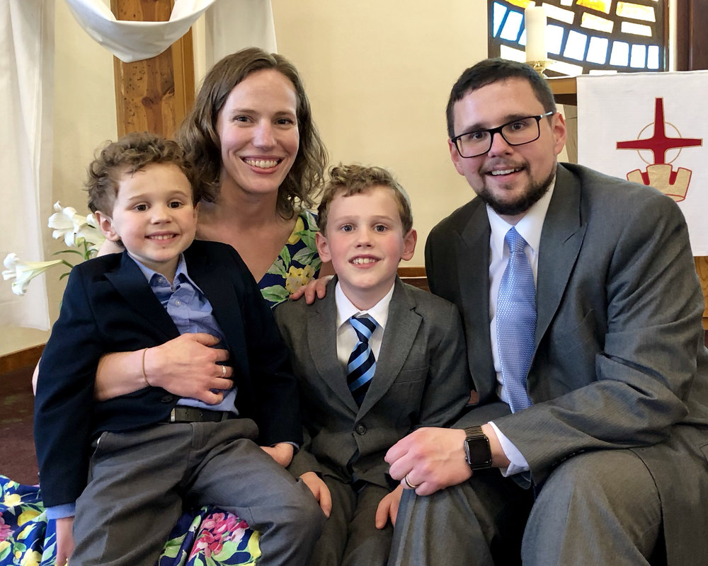 Pastor Shrimpton, his wife Karen, and their sons Alex (right) and Oliver (left).