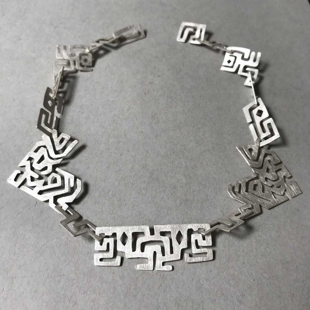 """Maze - Sterling Silver, 2016We are born into this maze called life, and begin to move around, driven by the necessity to survive and the desire to explore. Along the way we take wrong turns, hit dead ends and almost always end up in unexpected places.I believe a heightened awareness of our journey is what allows us to have appreciation and wisdom. With a sense of enlightenment we are able to realize that in the end, all those """"wrong turns"""" were actually simply parts of the puzzle that comprise a beautiful life story."""