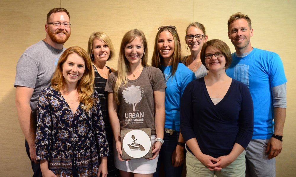 2015 Board Members: Back left to right. Greg Van Den Berghe, Melanie Allen, Courtney Long, Ciji Mitrisin, Drew Maifield. Front left to right. Emily Steele, Bethany Wilcoxon, Amy Luebbert