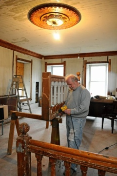 Jim Klock working to restore the Station House back to its original state.