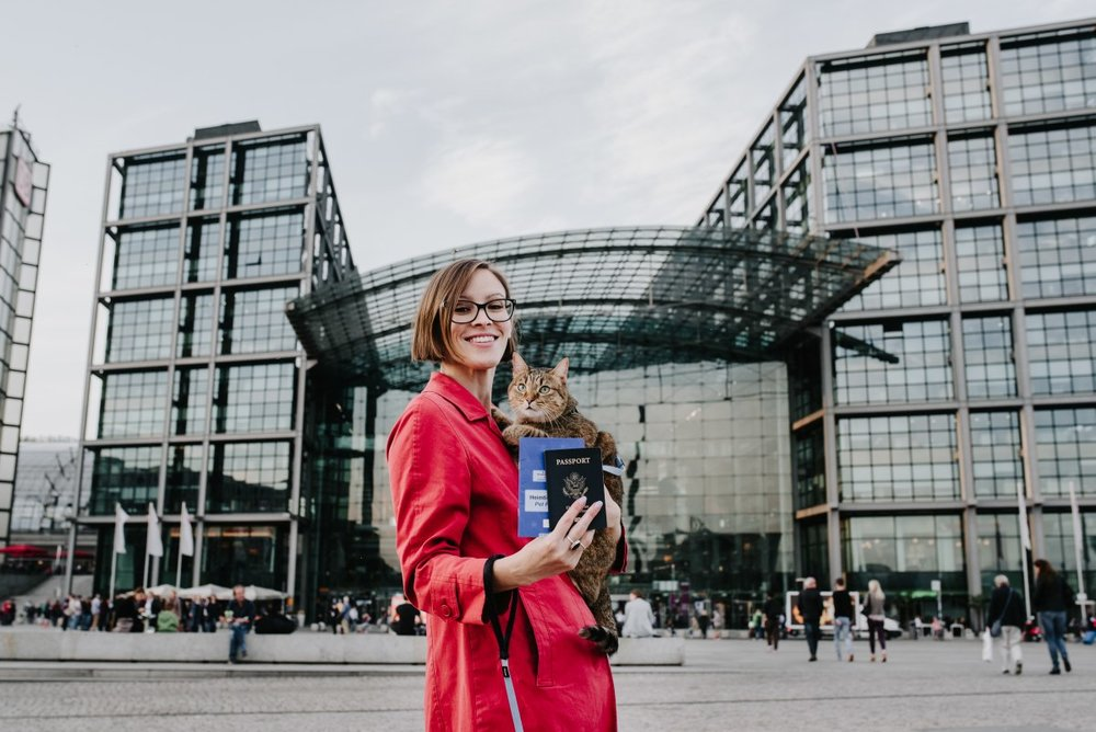 Outside Berlin Hauptbahnhof (central train station). My passport, and Aífe's. Yes, vets in the EU can issue pet passports. Read all about planes, trains, and the bureaucracy of pet travel in my little book. Photo by Juliana Socher.