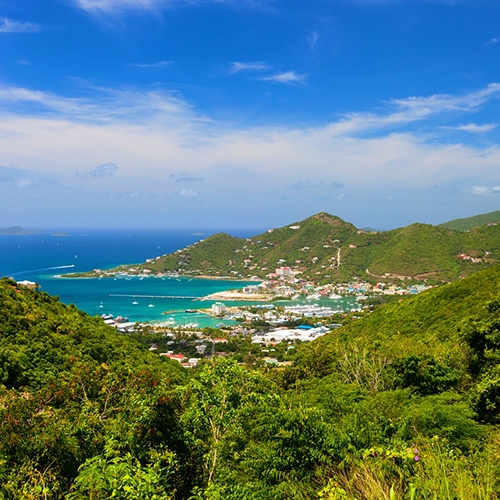 Tortola      /tɔːrˈtoʊlə/    is the largest and most populated of the   British Virgin Islands  , a group of islands that form part of the   archipelago   of the   Virgin Islands  .  [1]   It has a   surface area   of 55 square kilometres (21 square miles) with a total population of 23,908, with 9400 residents in   Road Town  .   Mount Sage   is its highest point at 530 metres (1,740 feet)   above sea level  .