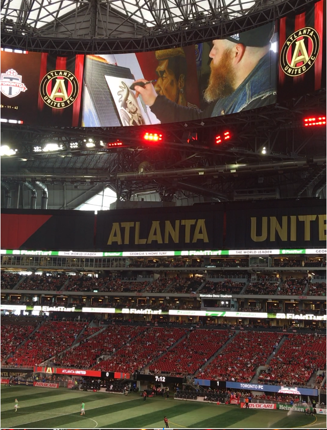 Jert video profile segment on halo board at halftime of Atlanta United Match at Mercedes Benz Stadium, August 2018