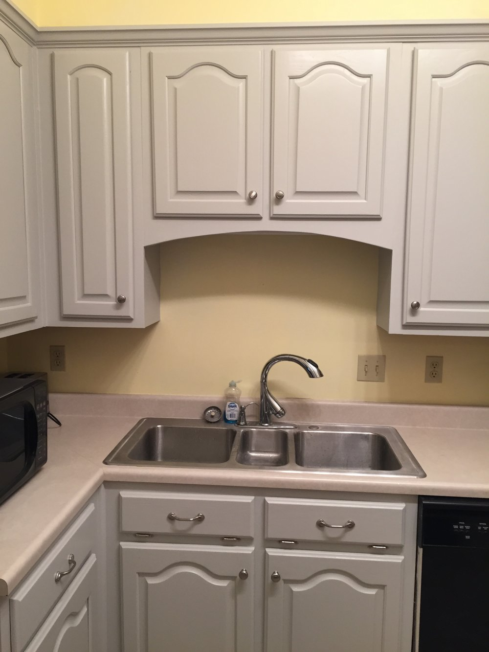Though a subtle change, we also faired the curve of the valence panel above the sink.  It was sporting a country sampler circa 1989 look prior.