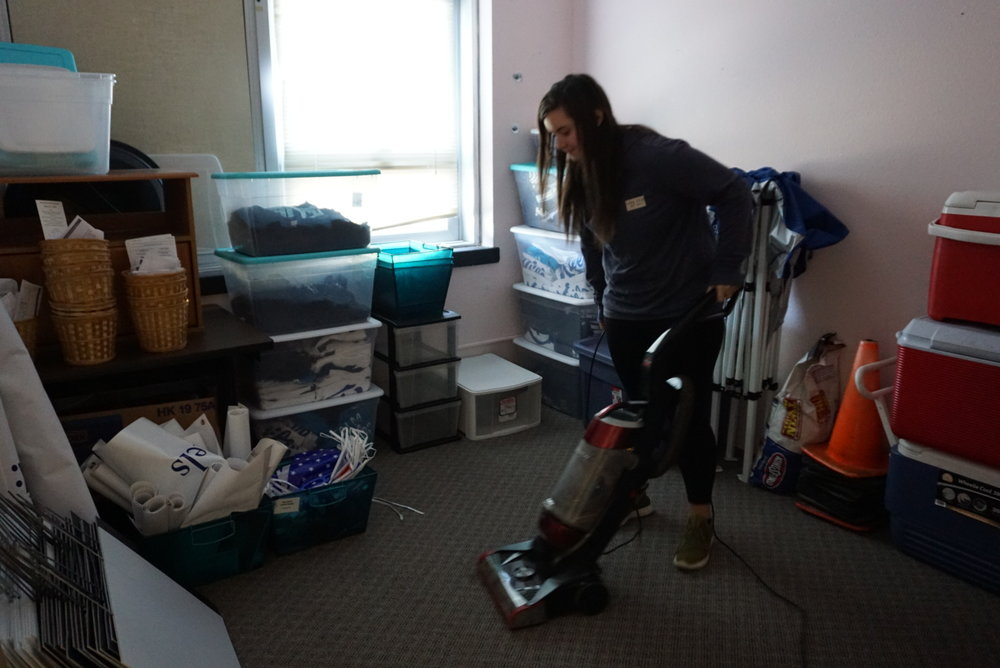 student vacuuming