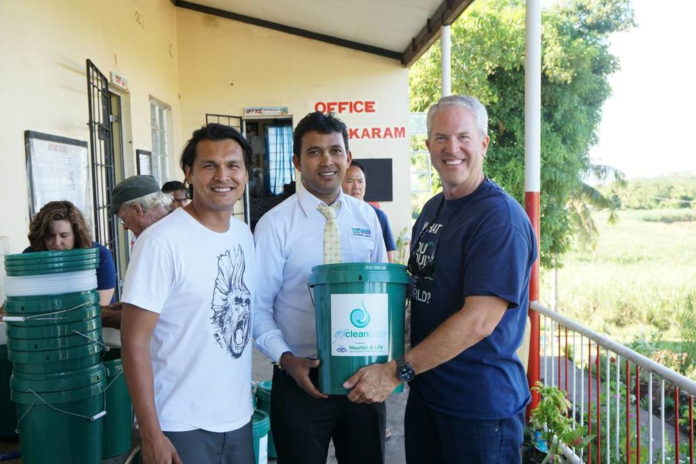 Left to right: Actor Adam Beach, Fiji Western Division Health Inspector Rakesh Kumar, and Give Clean Water founder Darrel Larson.