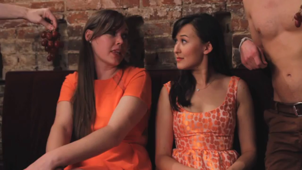 "Emily (right) in a still from ""Ladies Room"""