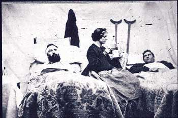 Civil War nurse attending to wounded soldiers.
