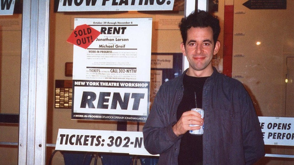 Jonathan Larson with a poster for RENT outside New York Theatre Workshop
