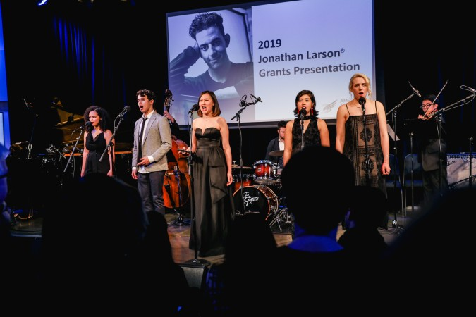 """The Man In Paris"" from Untitled Cherry Orchard Musical, music & lyrics by Emily Gardner Xu Hall. Pictured: Jordan Tyson, Charlie Oh, Emily Gardner Xu Hall, Jeremy Smith (drums), Isabella Dawis, Rachael Duddy, Jay Julio (violin). Photo: Marc J. Franklin for Playbill"