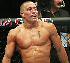"MMA legend Georges ""Rush"" St. Pierre. 2 league, and 3 time UFC Welterweight Champion, record of 25-2 (13 KO/Sub). Holds black belts in 4 different martial arts. 3 time ESPY ""Fighter of the Year"", 3 time ""Canadian Athlete of the Year"", set 9 UFC records. Consensus most well-rounded MMA fighter of all time, top 3 all time pound-for-pound."