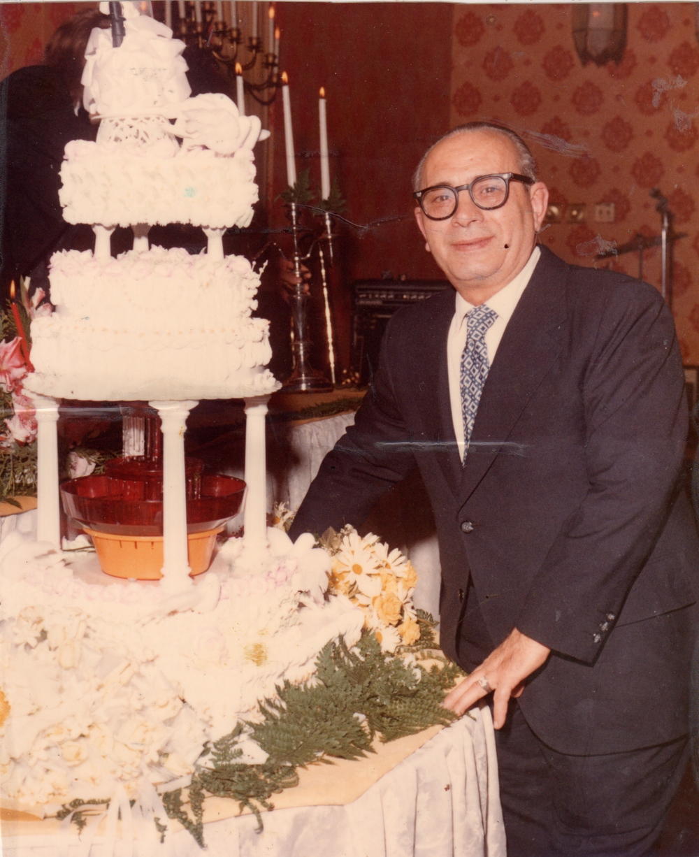 Sal & one of his Wedding Cakes.jpg