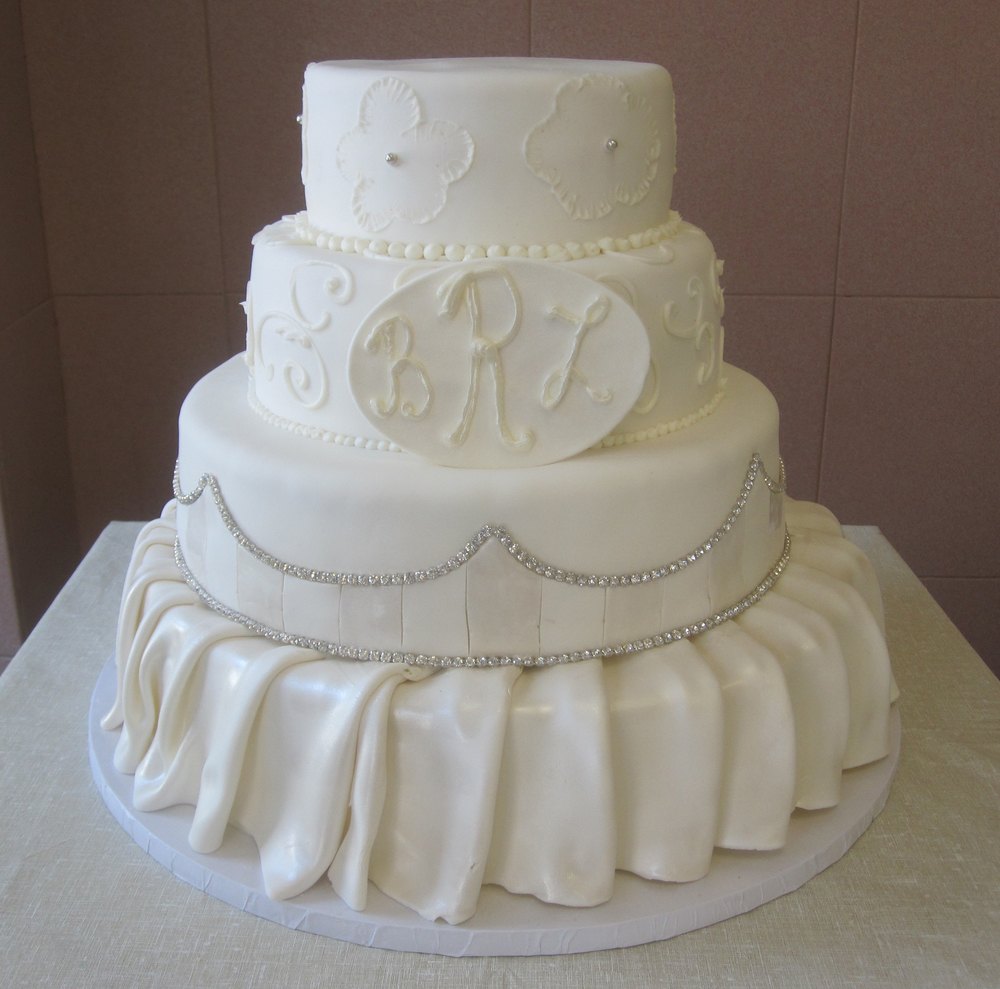 Ivory Rolled Fondant Skirted, Two Tone Arch Work, Monogram & Brushed Butter Cream