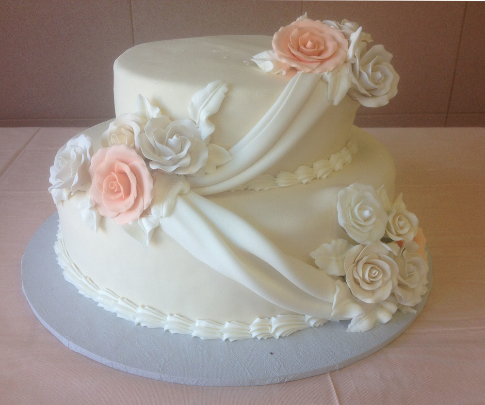 46 2 Tier in Ivory with White. Roses are Peach, White & Ivory