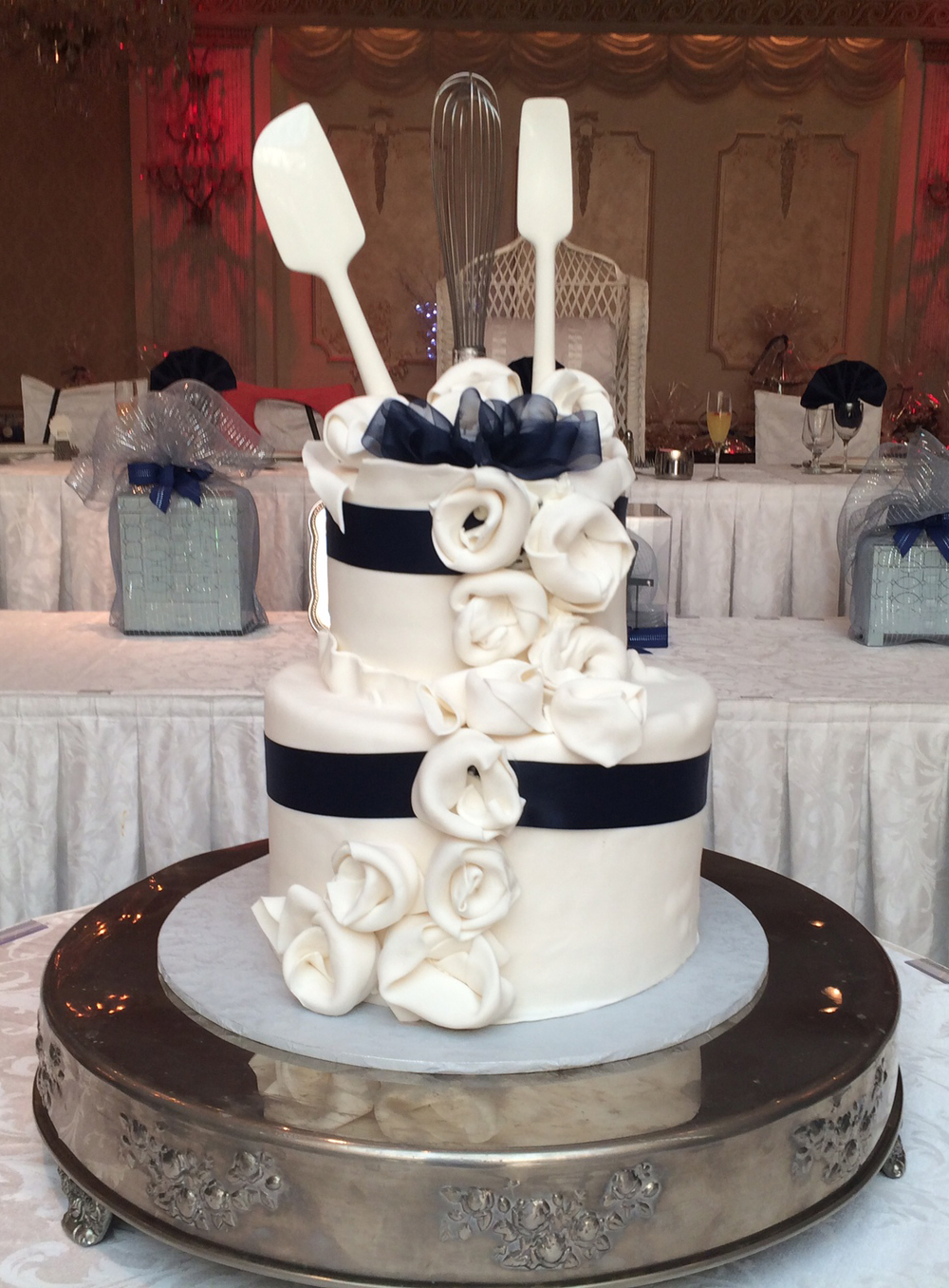 Double Tiered Rolled fondant Wrapped with Towels & Ribbons