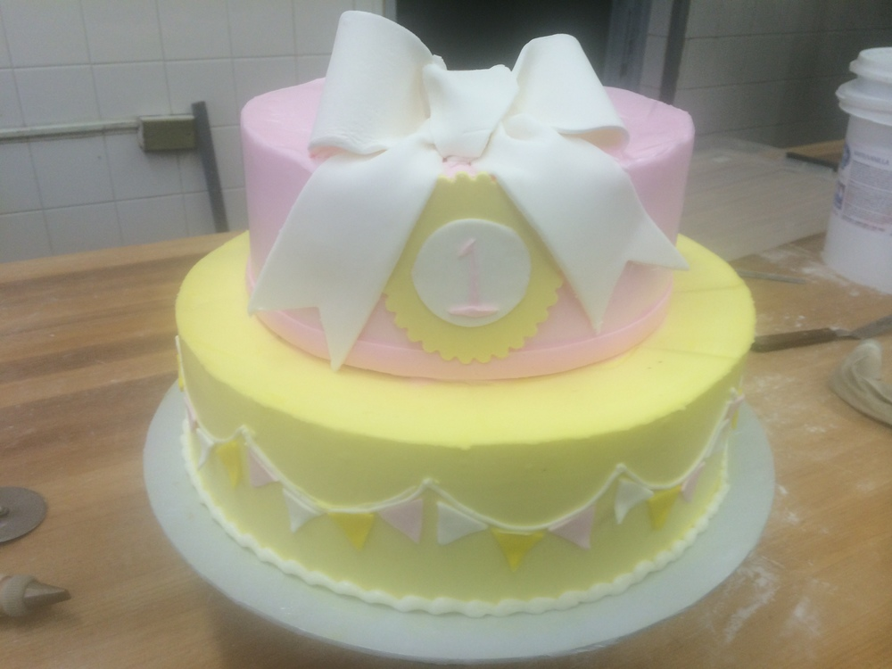 Colored Butter Cream with Pennants around, Bow on Top