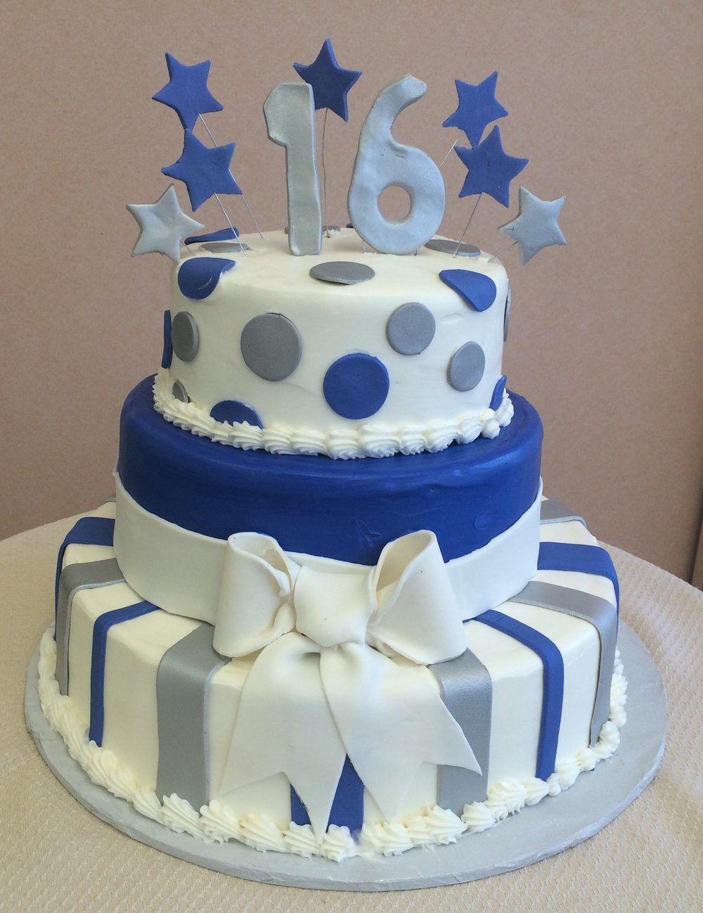 White & Color Butter Cream with Rolled Fondant Stripes, Bow, & Band. Polka Dots, Standing Numbers & Floating Stars in Silver