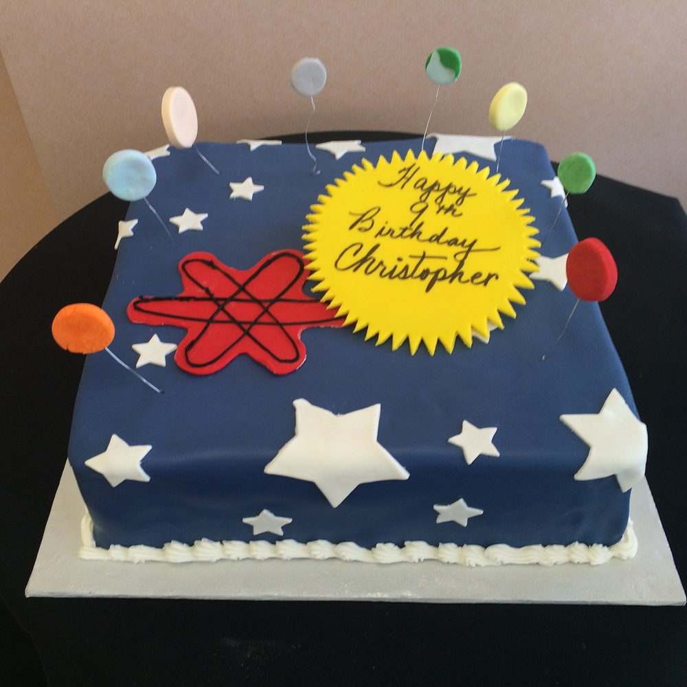 Navy Rolled Fondant Outerspace with floating planets .jpg