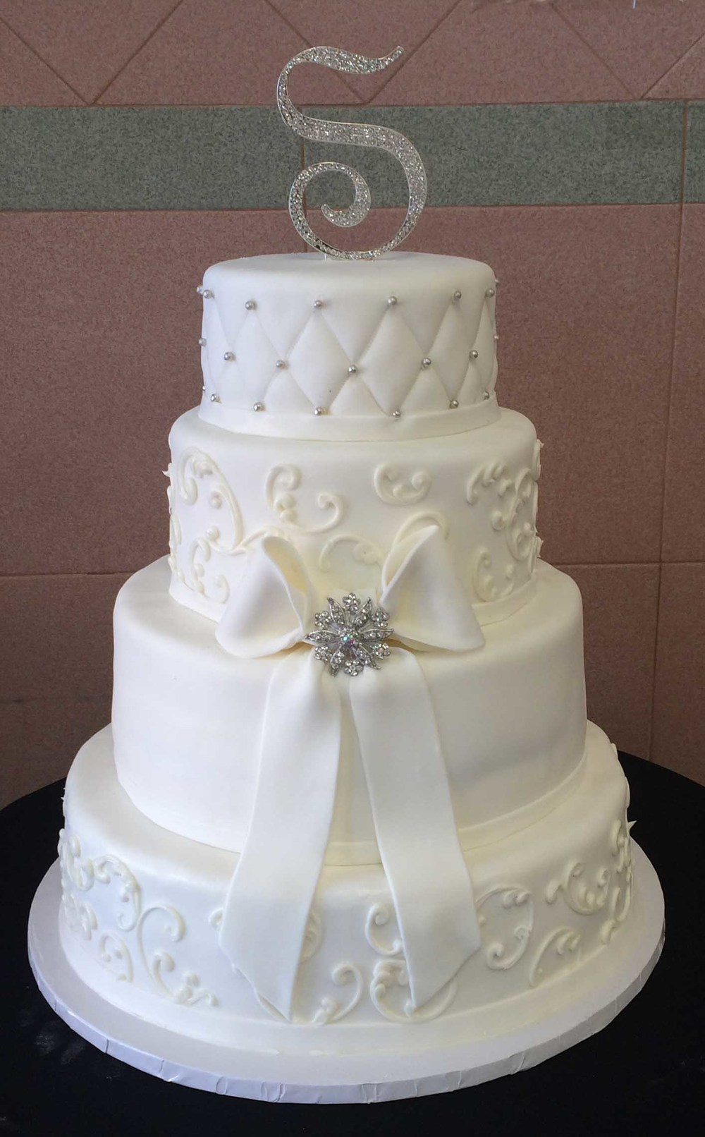 White Rolled Fondant. White Rolled Fondant Bands. Scrolls. White Bow & Brooch. Quilted with Silver. Crystal Monogram.jpg