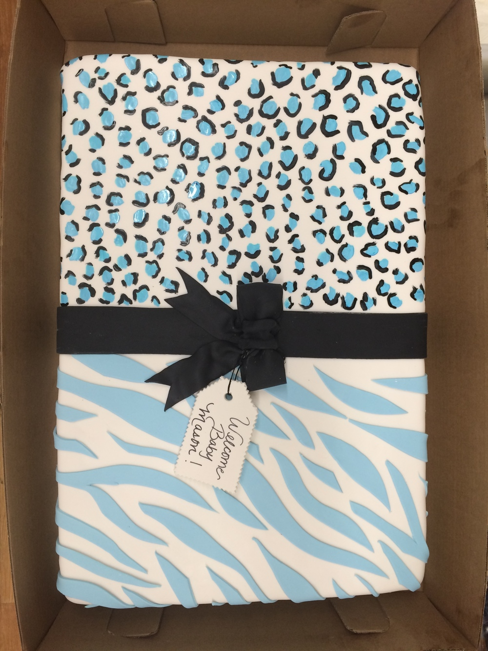 Single Tier Leopard and Zebra print with Rolled Fondant Bow.jpg