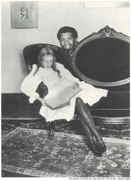 "Kareem Abdul-Jabbar Hides behind Girl Sitting on Couch Reading a Book (Physical Collage - 2011)    [Price: $175 / Framed: 9"" x 11.5"" - Unframed: 6.75"" x 9.5""]"